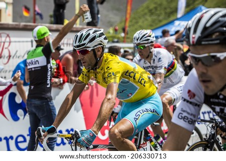COL DU LAUTARET,FRANCE - JUL 19: Vincenzo Nibali ( Team Astana) wearing the Yellow Jersey arrives on mountain pass Lautaret during the stage 14 of Le Tour de France on July 19 2014.  - stock photo