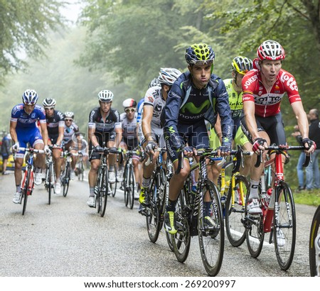 COL DU PLATZERWASEL, FRANCE - JUL 14:The peloton on the climbing road to mountain pass Platzerwasel in Vosges Mountains, during the stage 10 of Le Tour de France on July 14 2014 - stock photo