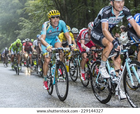 COL DU PLATZERWASEL,FRANCE - JUL 14:Ukrainian cyclist Andriy Hrivko (Astana) cycling in the peloton on the road to mountain pass Platzerwasel, Vosges Mountains,during Le Tour de France on July 14 2014 - stock photo
