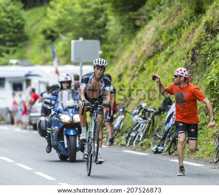 COL DU TOURMALET, FRANCE - JUL 24, 2014:Mateo Trentin riding on one wheel while climbing the road to Col du Tourmalet in Pyerenees mountains during the stage 18 of Le Tour de France on July 24, 2014. - stock photo