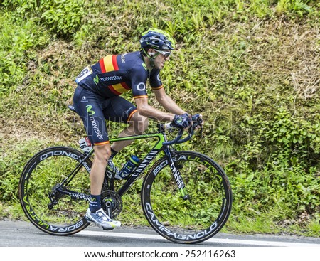COL DU TOURMALET, FRANCE - JUL 24: The cyclist Jon Izagirre Insausti (MovistarTeam) climbing the difficult road to Col de Tourmalet in the stage 18 of Le Tour de France on July 24, 2014. - stock photo