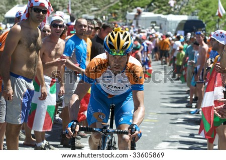 COL DU TOURMALET, FRANCE - JULY 12: A Garmin rider climbs the Col du Tourmalet in Stage 9 of the 2009 Tour de France on July 12, 2009 in France. - stock photo