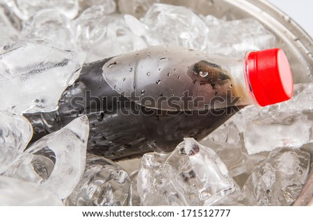 Cola drinks cooled with ice cubes - stock photo