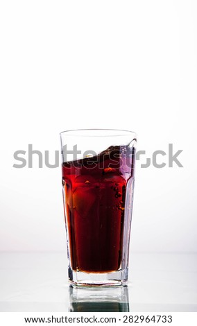 Cola glass with ice cubes on a white background - stock photo