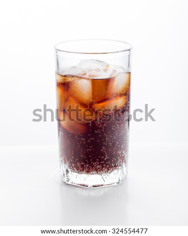 Cola glass with ice cubes on a white background. - stock photo