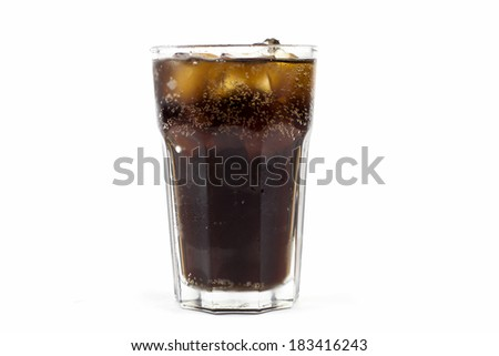 Cola in glass with ice on white background - stock photo