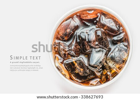 Cola in glass with ice on white background Close up and top view - stock photo