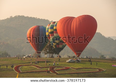 Cold air balloon The heart-shaped red flowers - stock photo
