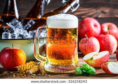 Cold and fresh cider beer with apples - stock photo