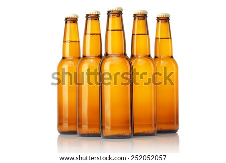 Cold  beer bottles on a white background. - stock photo