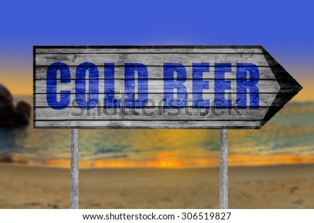 Cold Beer wooden sign with on a beach background - stock photo