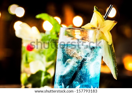Cold blue cocktail in a night party. - stock photo