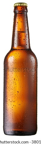 Cold bottle of beer with condensated water drops on it. File contains clipping paths. - stock photo