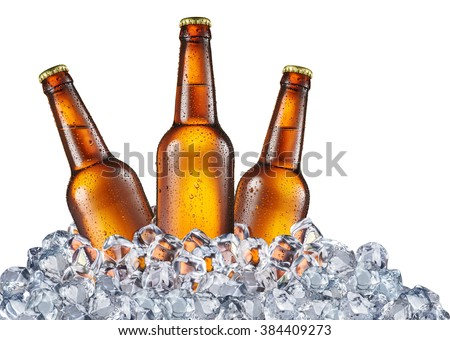 Cold bottles of beer in the ice cubes. File contains clipping paths. - stock photo