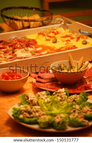 Cold buffet A cold buffet with sausages, vegetables and bread.  - stock photo