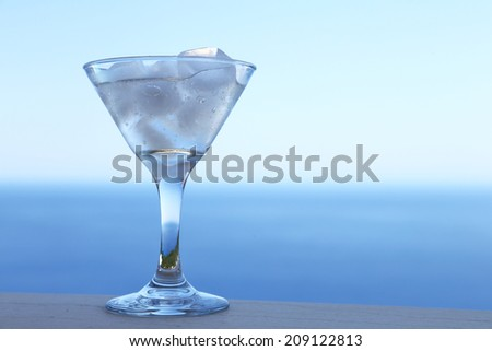 Cold cocktail with ice cubes and relaxing summer background - stock photo
