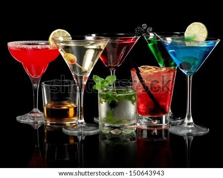 Cold color cocktails on black background - stock photo