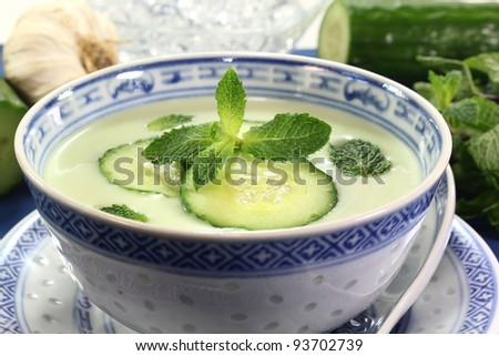 cold cucumber soup with slices of cucumber and mint - stock photo
