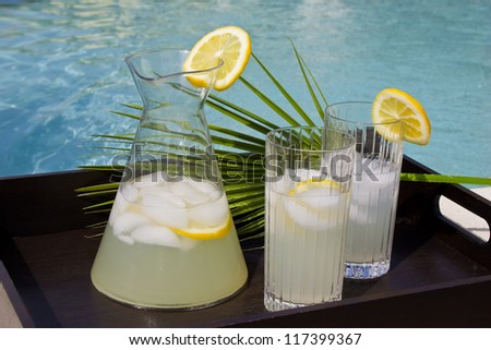 Cold drinks by the pool - stock photo