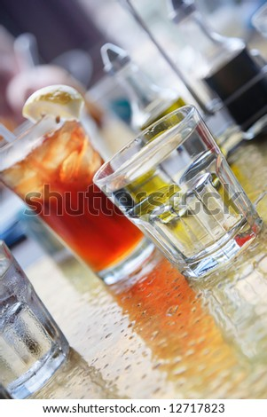 Cold drinks on a table. Shallow DOF. - stock photo