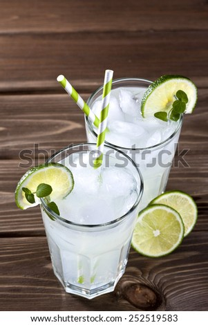 Cold drinks on a wood background - stock photo