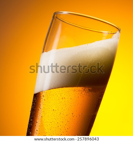 cold fresh beer in a glass with dew drops - stock photo