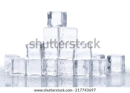 Cold. Frozen ice cubes on the table - stock photo