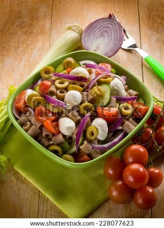 cold pasta salad with mozzarella - stock photo