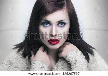 Cold portrait of a young lady with red lips - stock photo