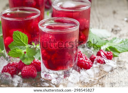 Cold Raspberry drink with mint and ice, selective focus - stock photo
