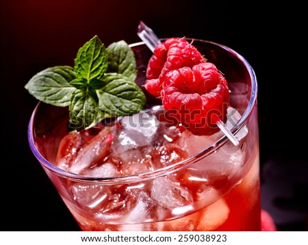 Cold red drink  with raspberry and mint leaf. Top view. - stock photo
