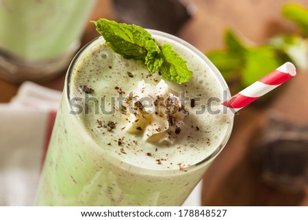 Cold Refreshing Mint Chocolate Chip MilkShake with a Straw - stock photo