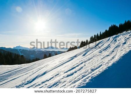 cold snow ski slope on Alps mountain in Portes du Soleil region, Morzine - Avoriaz, France - stock photo