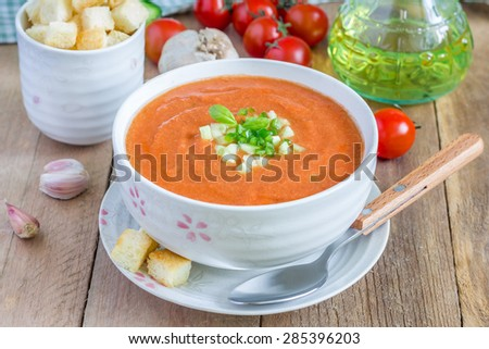 Cold tomato soup gazpacho in a bowl with croutons  - stock photo