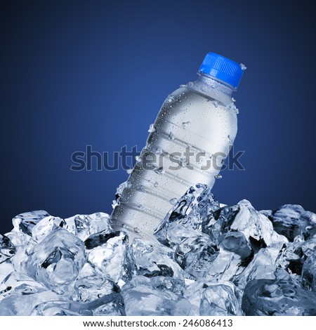 Cold Water Bottle On Ice Cubes - stock photo