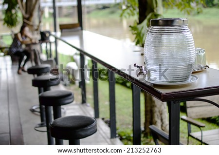 Cold water dispensers on table - stock photo