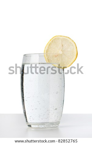 Cold water glass with lemon - stock photo