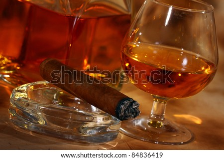 Cold whiskey  and cigar against ancient background - stock photo