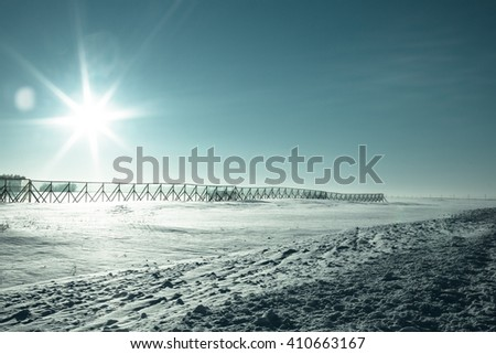 Cold winter wasteland. Evening. The sky and snow. - stock photo