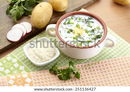 Cold yogurt soup with dill and yolk, russian traditional dish - okroshka - stock photo