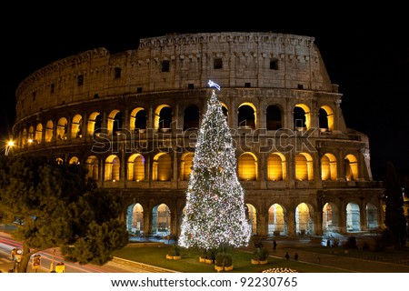 Coliseum and Christmas Tree in Rome, Italy - stock photo