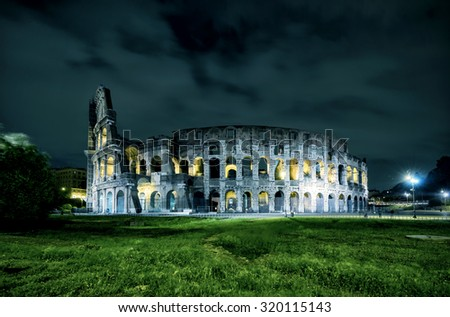 Coliseum (Colosseum) at night in Rome, Italy - stock photo