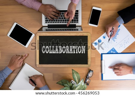 COLLABORATION Business team hands at work with financial reports and a laptop, top view - stock photo