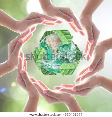 Collaborative human hands surrounding green planet protected by recycled bio sign leaf on blur abstract bokeh background: Recycle, reduce, reuse, CSR idea concept: Element of image furnished by NASA - stock photo