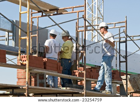 Collaborative Inspection, Workers on Scaffolding - stock photo