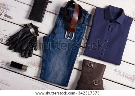 Collage of beautiful clothes on a wooden background. - stock photo