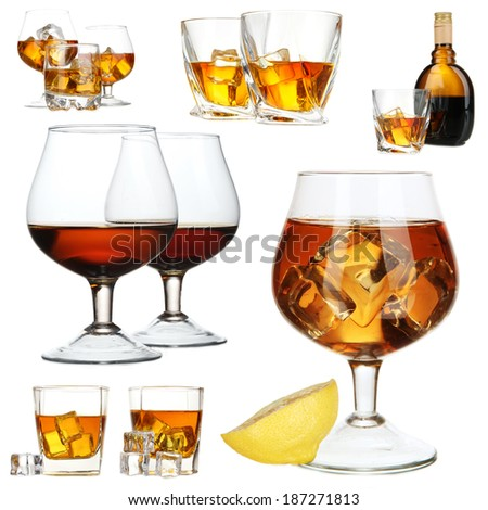 Collage of brandy glasses with ice cubes isolated on white - stock photo