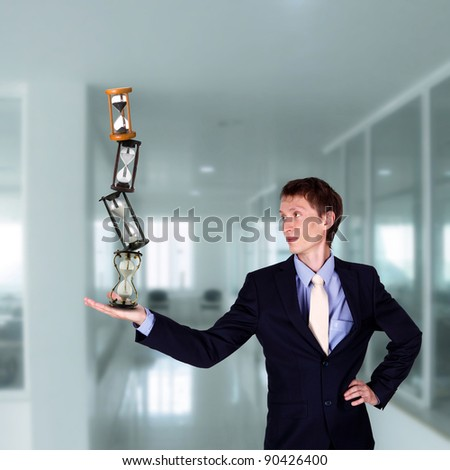collage of businessman in office holding clock pyramid - stock photo