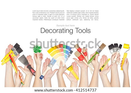 collage of decorating and house renovation tools in a hands isolated on white background - stock photo