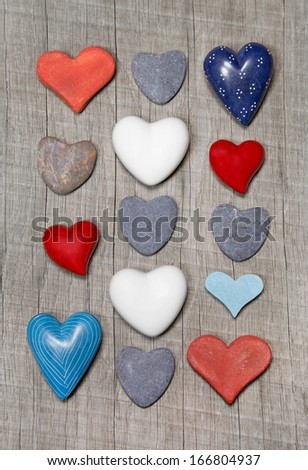 Collage of different hearts in blue, red and white with stones for valentines day. - stock photo